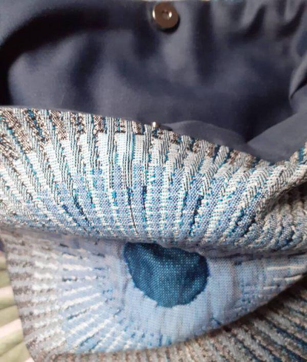 bolso artesanal de tela acolchada