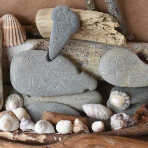 talla de piedra, ballenas talladas en piedra